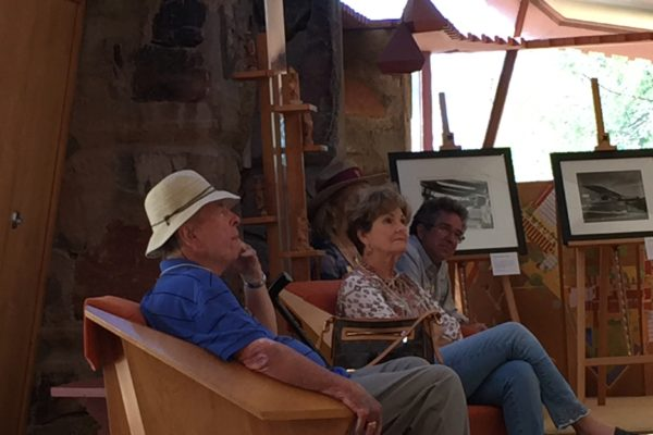 EHFA member Allen Hallock sits in Frank Lloyd Wright's chair at Taliesin. EHFA Genealogist Cindy Ward Clark is to his right.