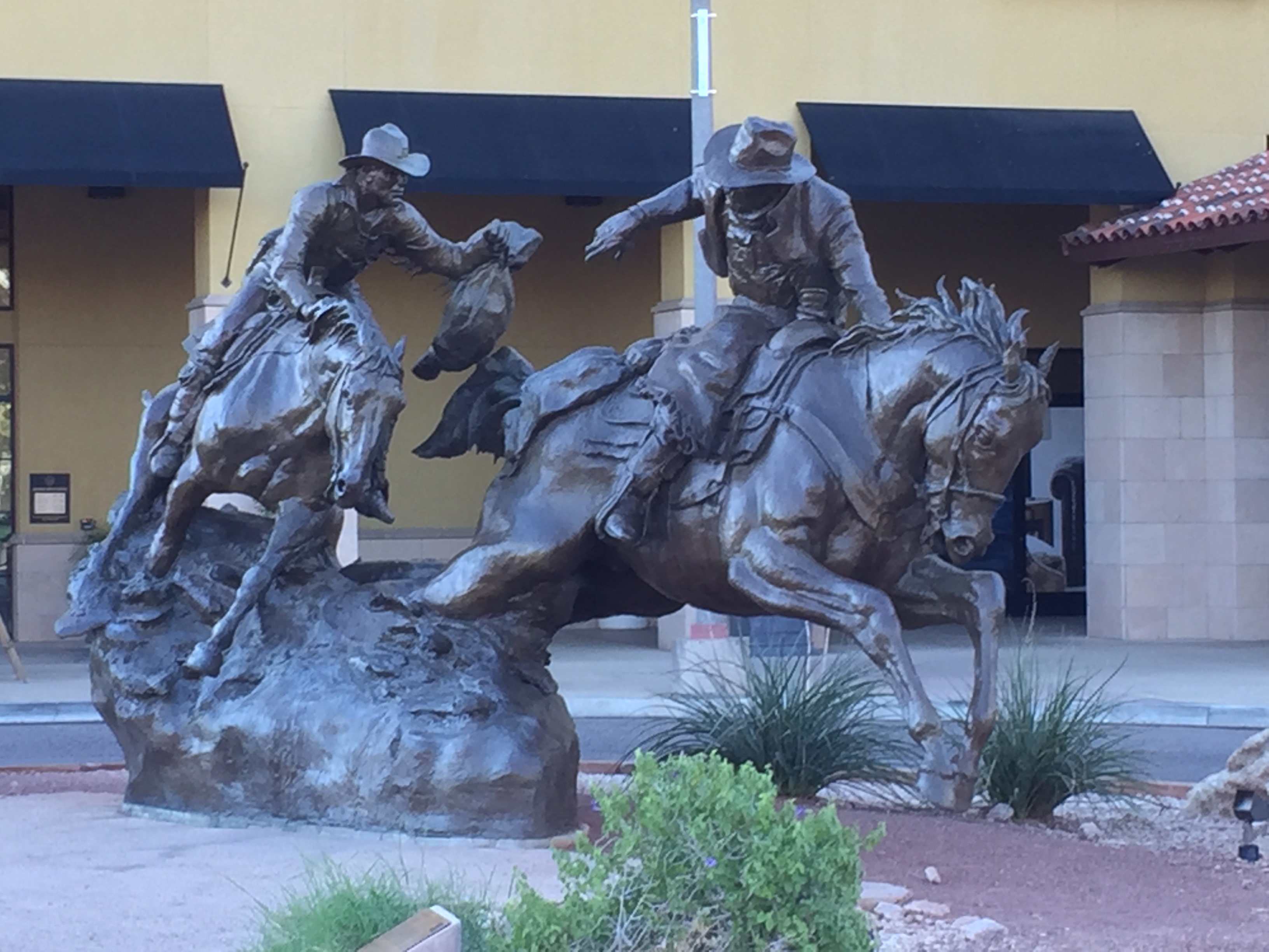 """The lifesize bronze statue """"Passing the Legacy"""" is the endpoint for the Annual Hashknife Pony Express ride in Scottsdale, Arizona."""