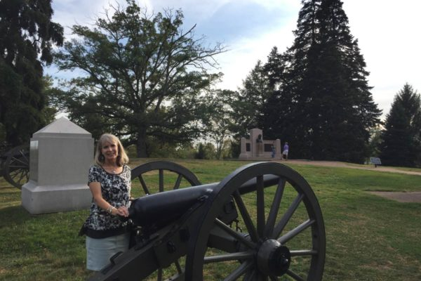 EHFA Foundation board member Mary Meyers near cannon in Gettysburg National Cemetery
